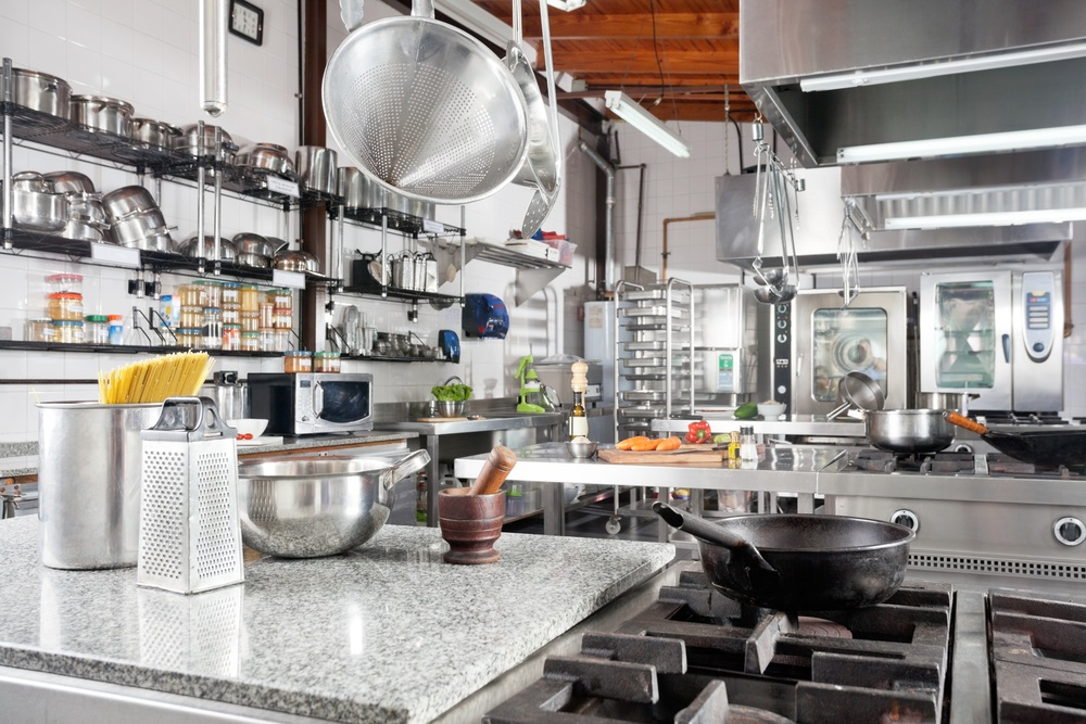 Variety of utensils on counter in commercial kitchen