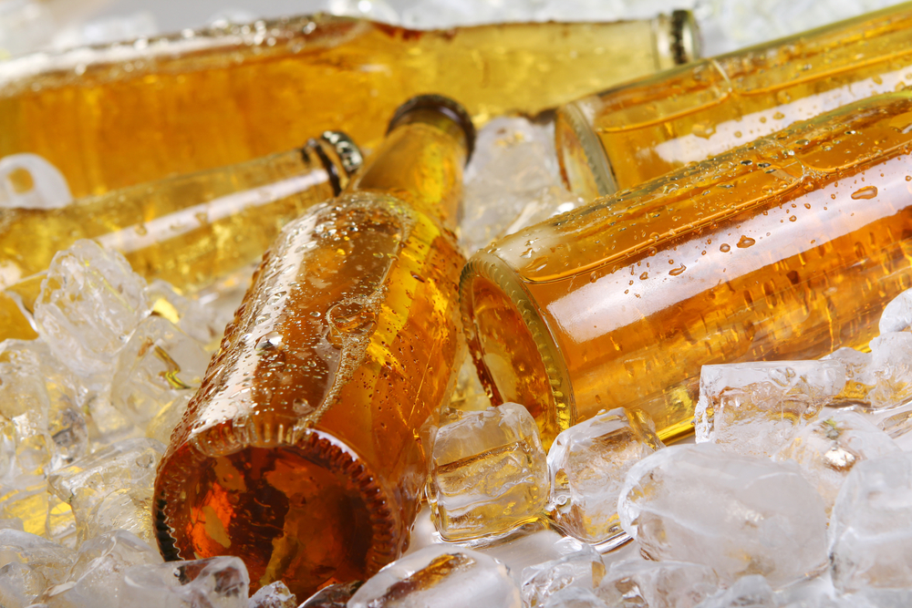 Yellow glass bottles on ice