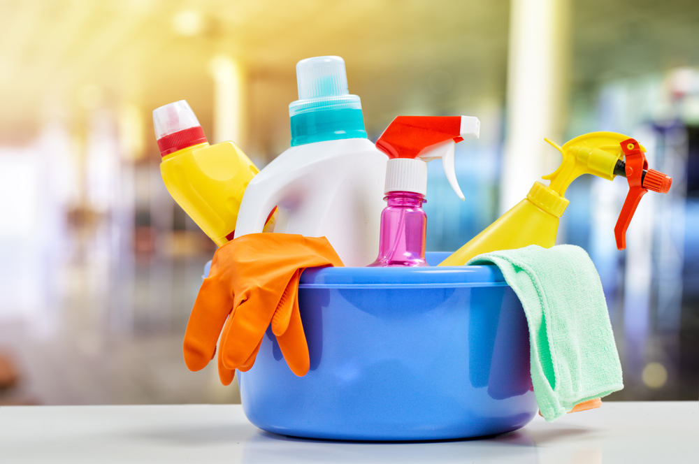 Various cleaners in a bucket